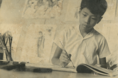 photo of Xiaoze Xie drawing in early age
