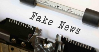 image of a type write with words: Fake News